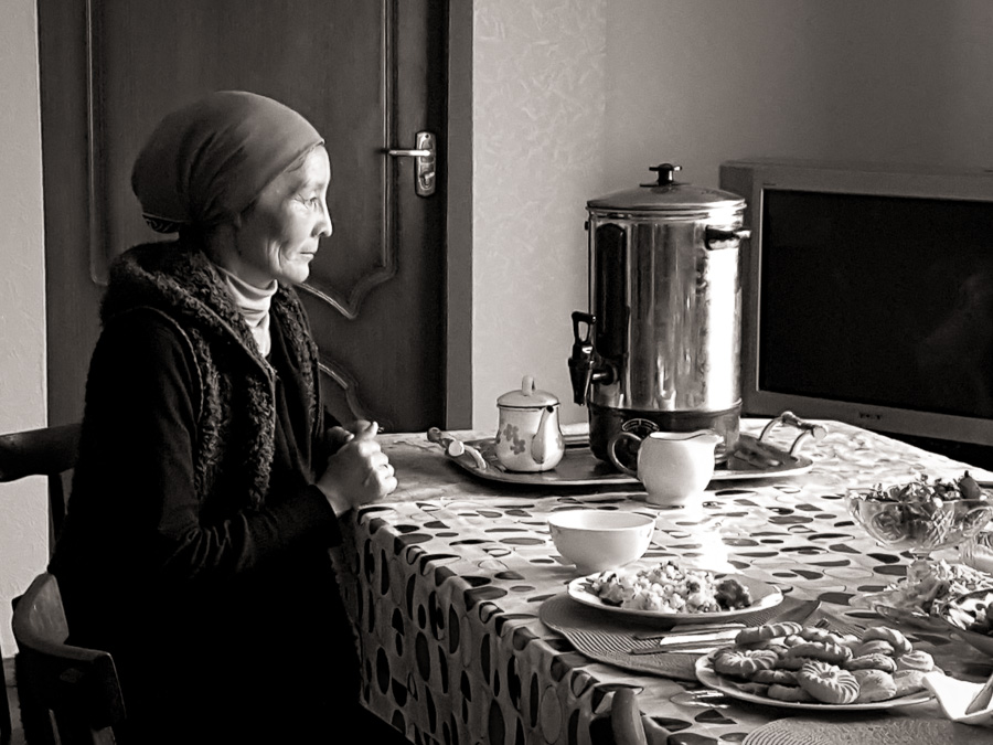 Kazakh woman waiting to serve tea