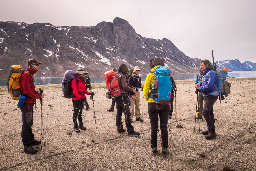 Maxime talking to the trekking group who are standing on the old runway at Bluie East Two