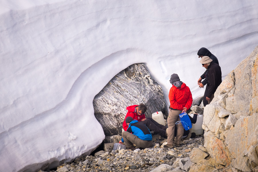 Maxime and the guys collecting melt water for us to use at the Tasiilaq Mountain Hut