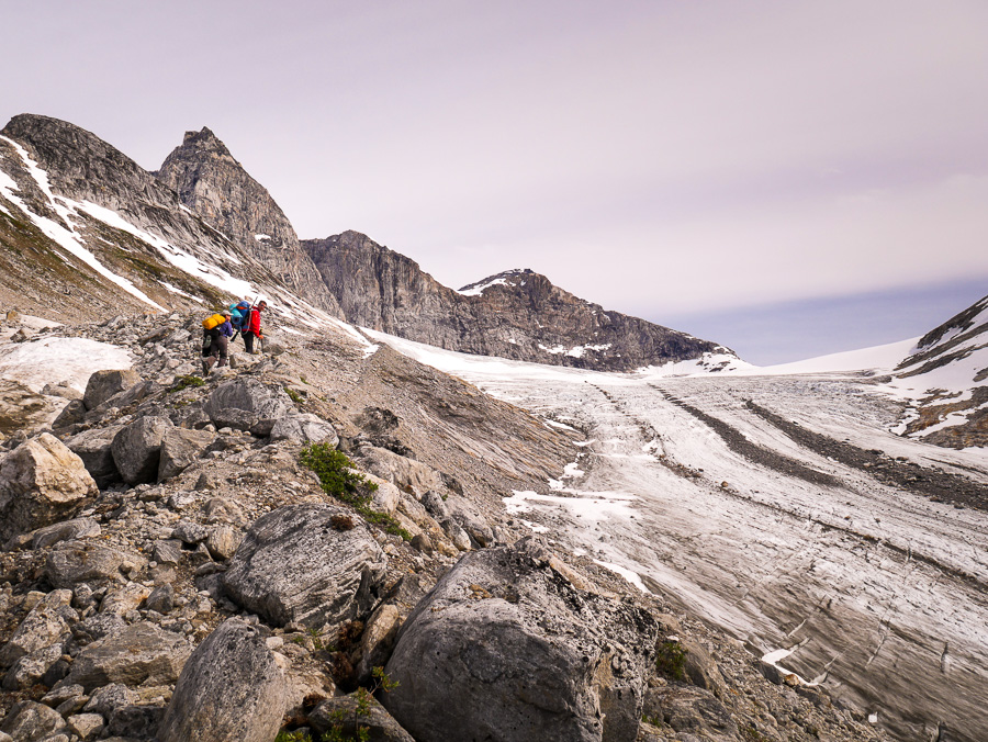 Maxime and I looking back towards our trekking companions as we climb the morraine beside the glacier on the way to the Tasiilaq Mountain Hut