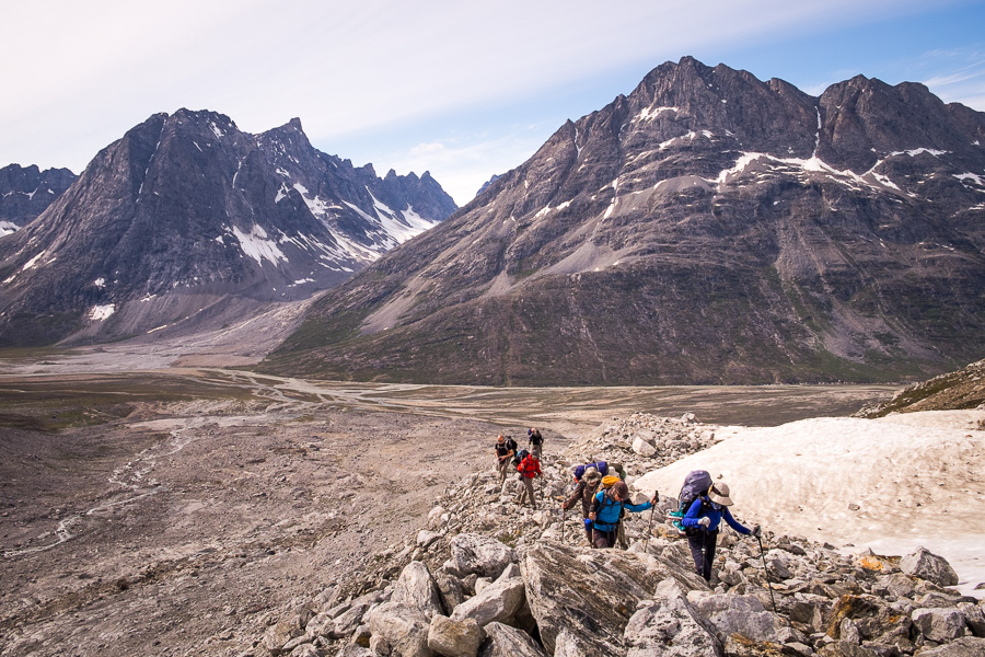 My trekking companions hiking up the glacial morraine on the way to Tasiilaq Mountain Hut with the Tasiilap Kua Valley below