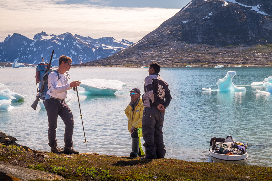 Maxime discussing exactly where to leave our camping gear with the speedboat drivers