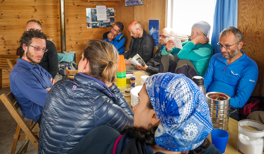 The group hanging out around the dining table at the Tasiilaq Mountain Hut