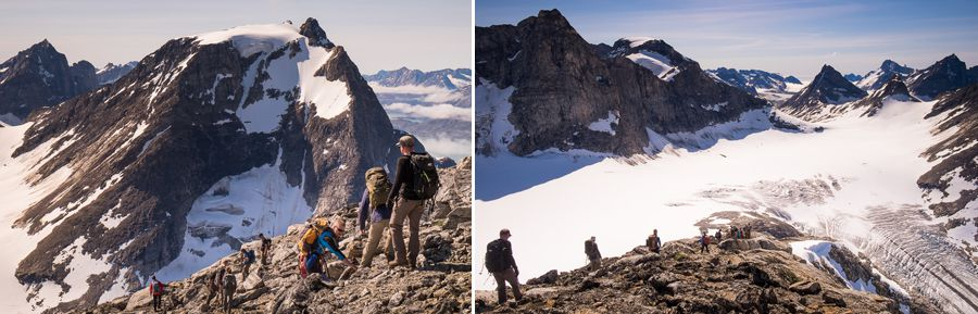 My trekking companions descending from the summit in front of me, with mountains and glacier in the background