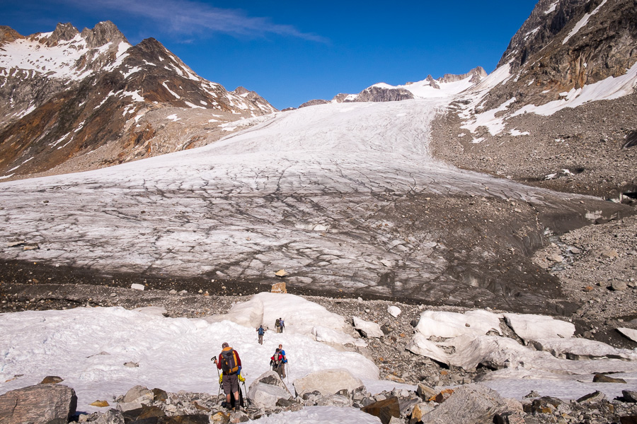 My trekking companions approach the glacier tongue that we had to cross in the Tasiilap Nua Valley. The glacier looks like a runway.