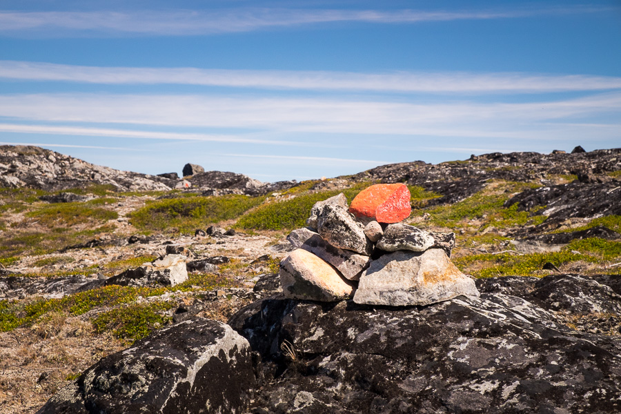 Red marks painted on rocks show the hiking routes around Igaliku in South Greenland