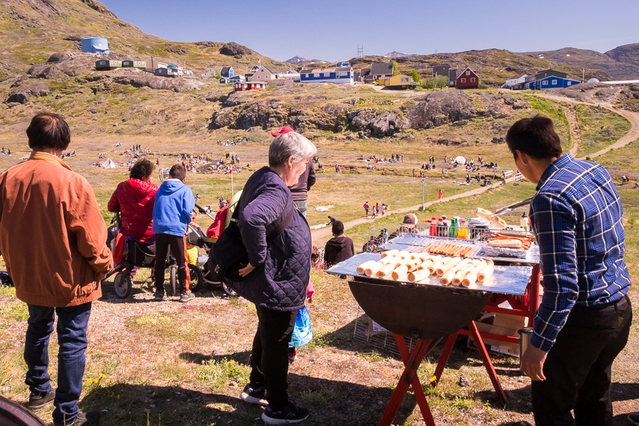 Narsaq locals enjoying a sausage sizzle for Greenland National Day