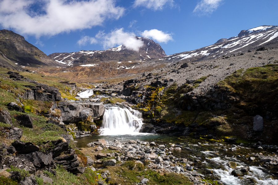 Small waterfall with Kuannersuit mountain in the background. As seen on the Kvanefjeld hike near Narsaq in South Greenland