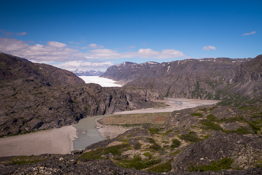 The river leading from the Glacier and the Glacier itself in background as seen from the viewpoint of the Ridge Hike near Narsarsuaq, South Greenland