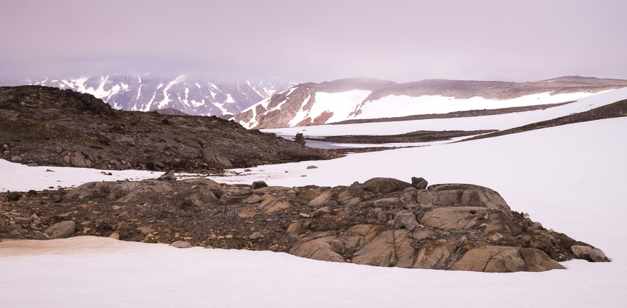 Snow drifts and very low cloud while hiking from Kulusuk to Isikajia, East Greenland