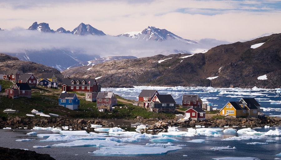 A view of Kulusuk, the second largest settlement in East Greenland, and icebergs in the fjord