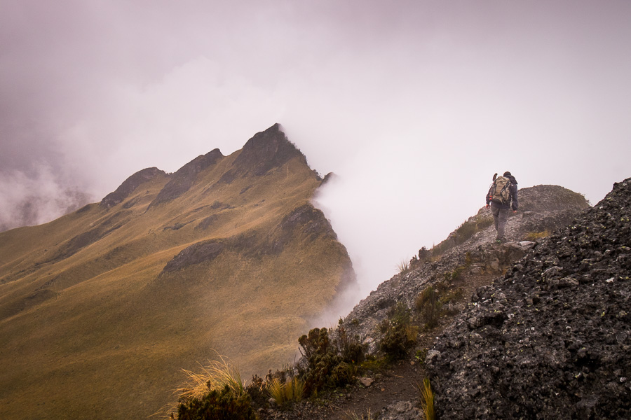2 of my hiking companions following the ridge lining the fog-filled crater of Volcán Pasochoa near Quito, Ecuador