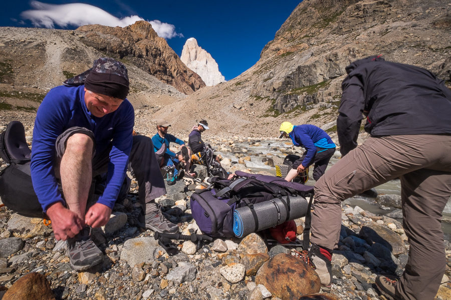 Trekking companions changing shoes - South Patagonia Icefield - Argentina