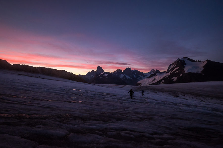 Trekking companions silhoutted against brightening eastern sky - Gorra Blanca - South Patagonia Icefield Expedition - Argentina