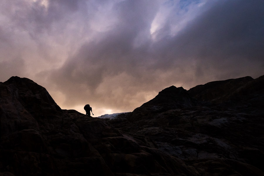Silhouette of trekking companion climbing toward the glacier - South Patagonia Icefield Expedition - Argentina