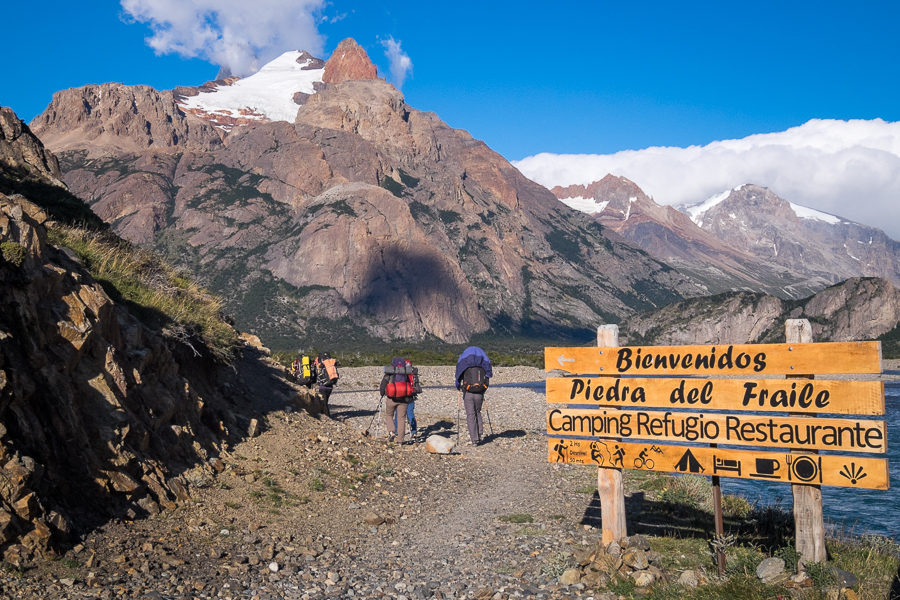 Trekking companions walking past sign to Piedra del Fraile - South Patagonia Icefield - Argentina