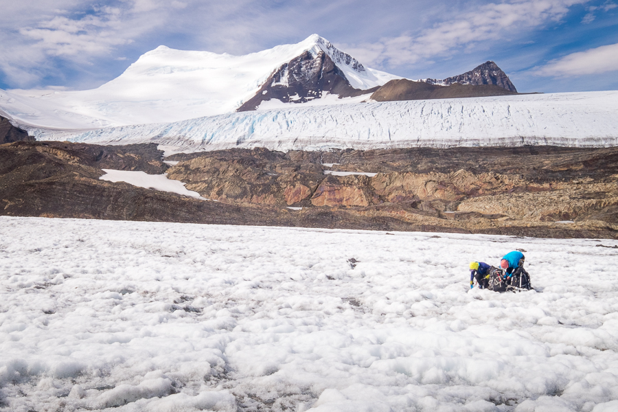 Juan and Rafa refilling water bags in front of Gorra Blanca - South Patagonia Icefield Expedition - Argentina