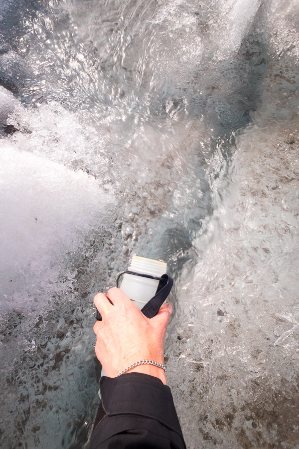 Refilling drink bottle from the glacier - South Patagonia Icefield Expedition - Argentina