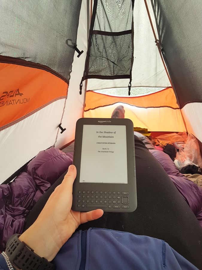Reading my kindle in my tent