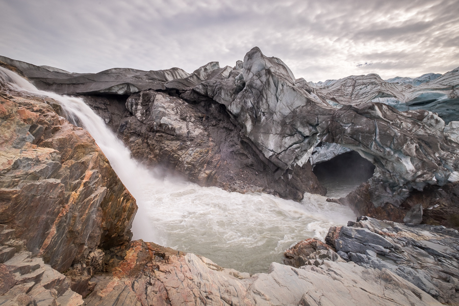 Waterfall and Ice cave at the base of the Russell Glacier near Kangerlussuaq, West Greenland