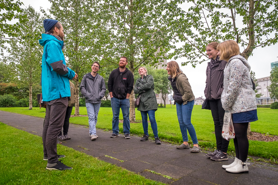 Stefan telling stories in the park near Landakotskirkja on the Icelandic Mythical walk by Your Friend in Reykjavik