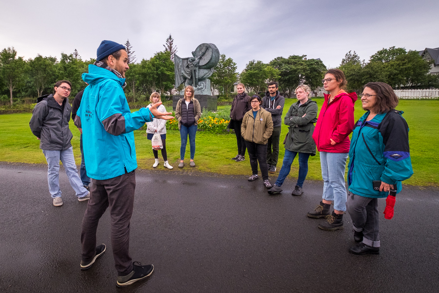 Stefan telling stories near the Úr Álögum statue on the Icelandic Mythical walk by Your Friend in Reykjavik