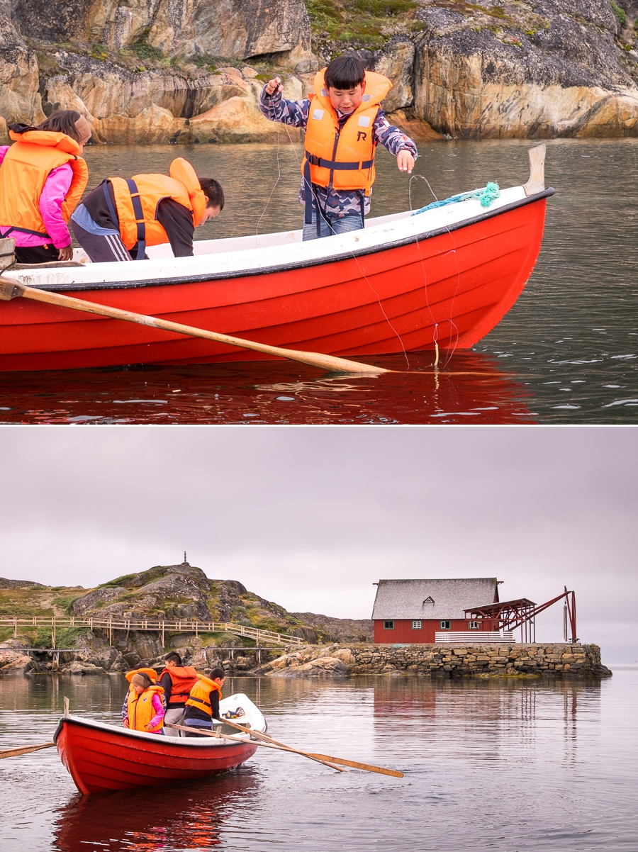 School kids fishing and maneuvering a canoe in Assaqutaq near Sisimiut, West Greenland
