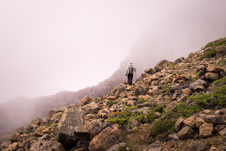 My friend hiking towards a mountain obscured in the fog between Assaqutaq and Sisimiut - West Greenland