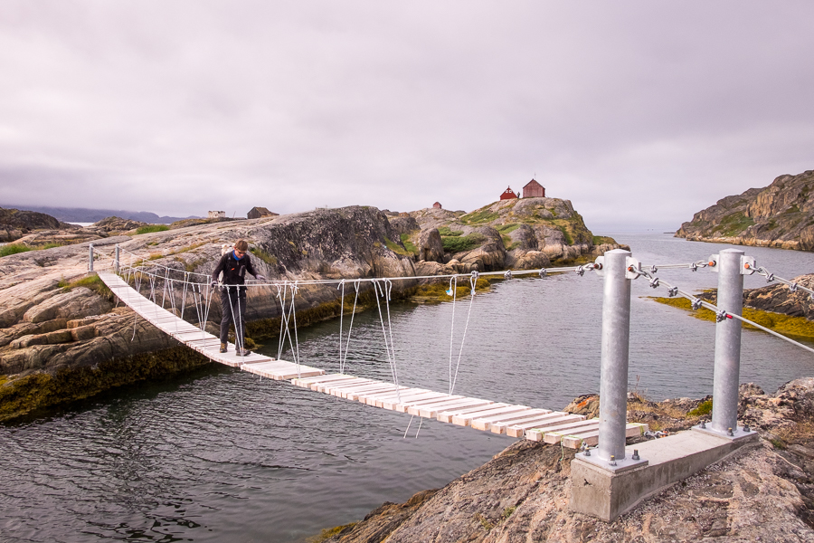 My friend making his way across the footbridge with Assaqutaq in the background, near Sisimiut, West Greenland