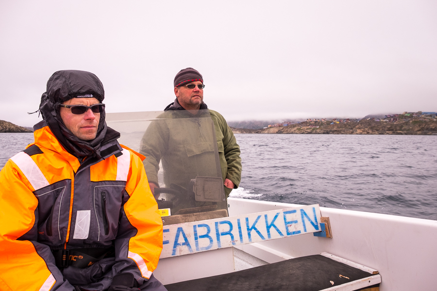 My friend in a freezer suit sitting in front of Jan with just a normal jacket on - Sisimiut Boat Safari - West Greenland