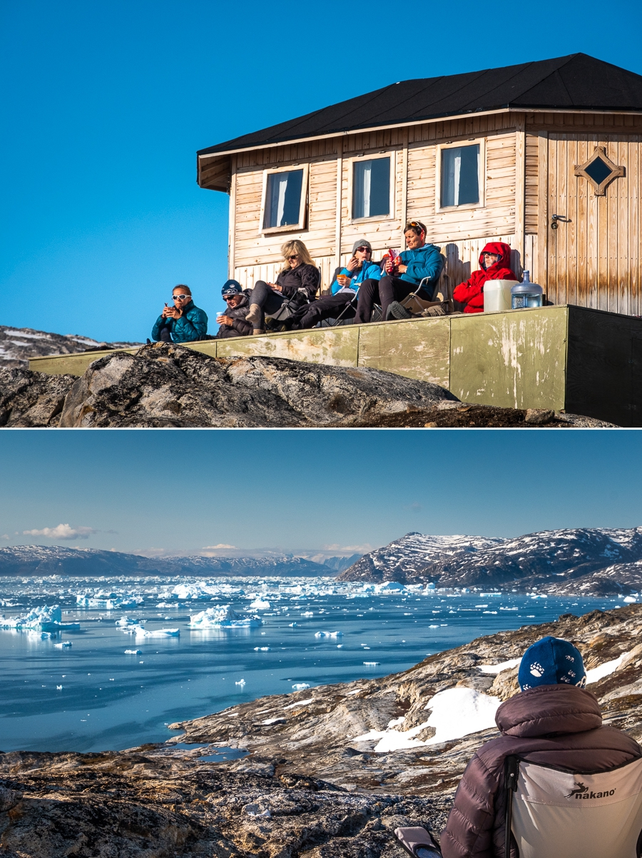 Sitting on porch of hut at Tinit enjoying the sun and afternoon tea - East Greenland