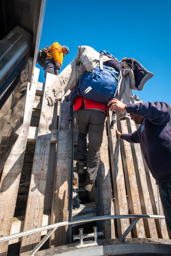 Climbing to the dock in Kuummiut harbour - East Greenland