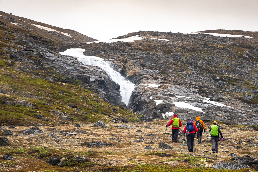 Hiking towards an unnamed waterfall near Kuummiut, East Greenland