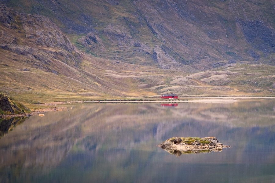 Canoe Center and mountains reflected in the still waters of Amitsorsuaq Lake - Arctic Circle Trail - West Greenland
