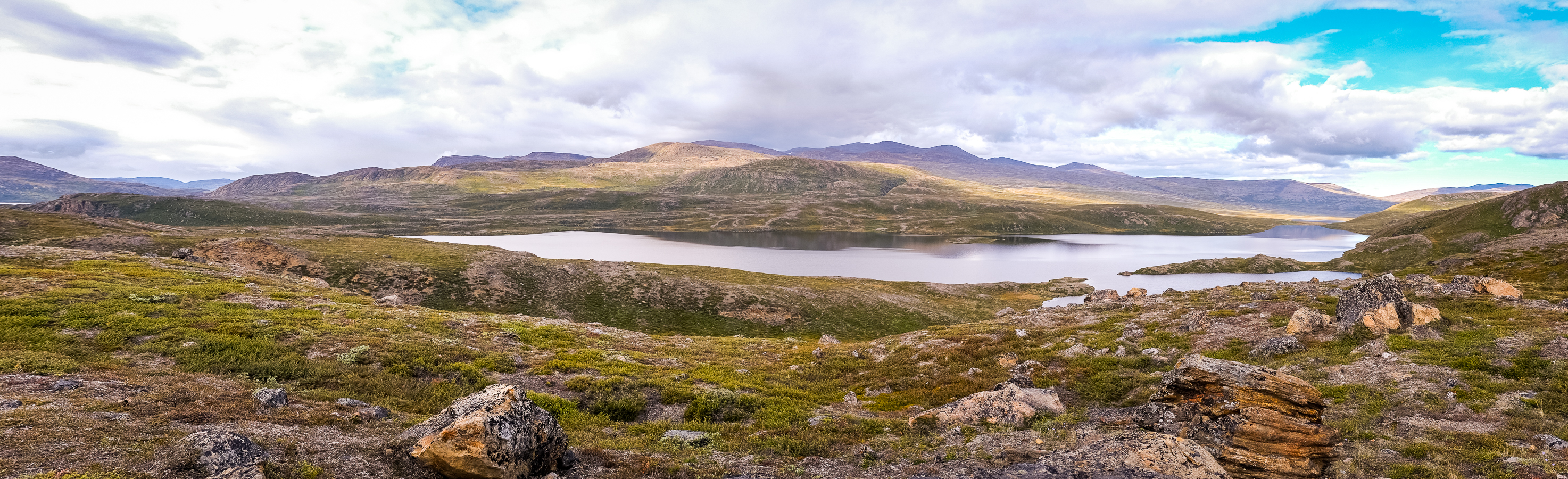 Panorama of the lake at the base of the Taseeqqap Saqqaa range - Arctic Circle Trail - West Greenland