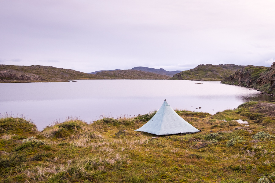 Tyson's tent set up on the lake near Ikkattooq Hut - Arctic Circle Trail - West Greenland