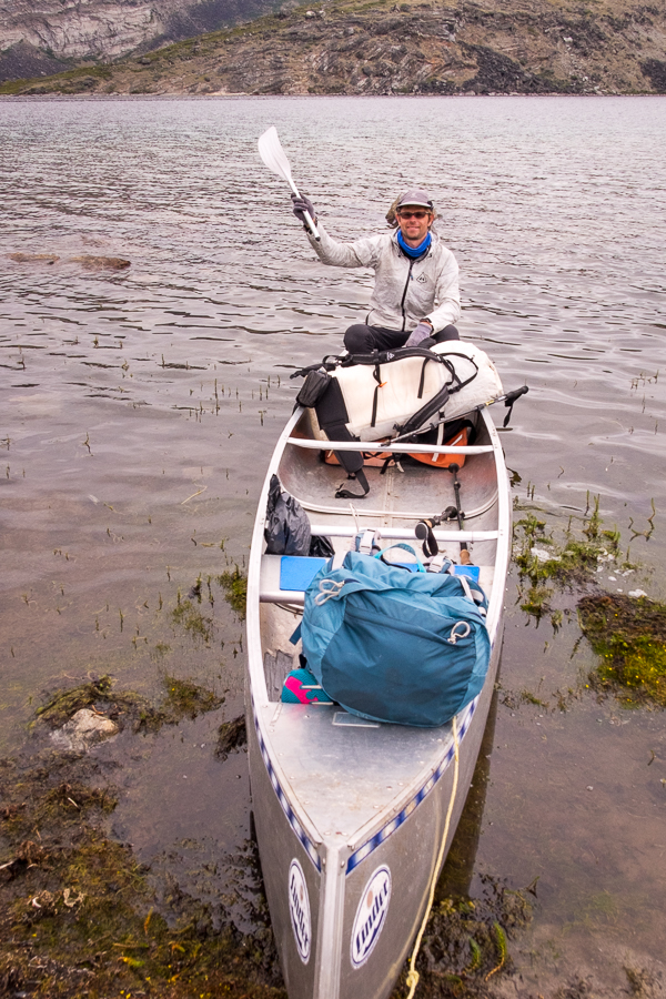 Tyson sitting in the canoe showing the half-paddle - Arctic Circle Trail - West Greenland