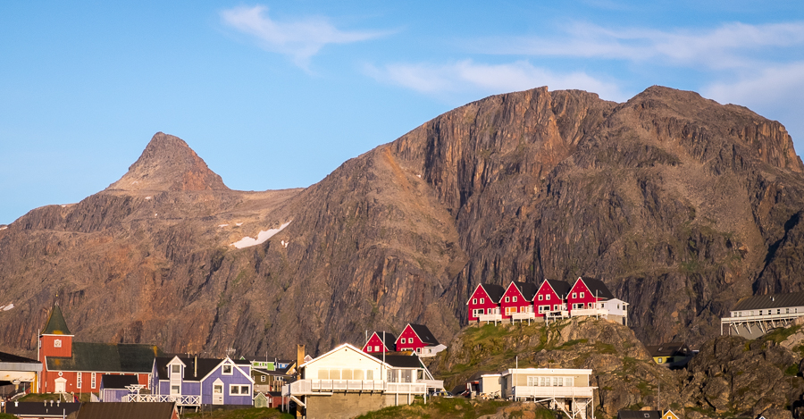 Nasaasaaq mountain rises steeply behind the colourful houses of Sisimiut - West Greenland