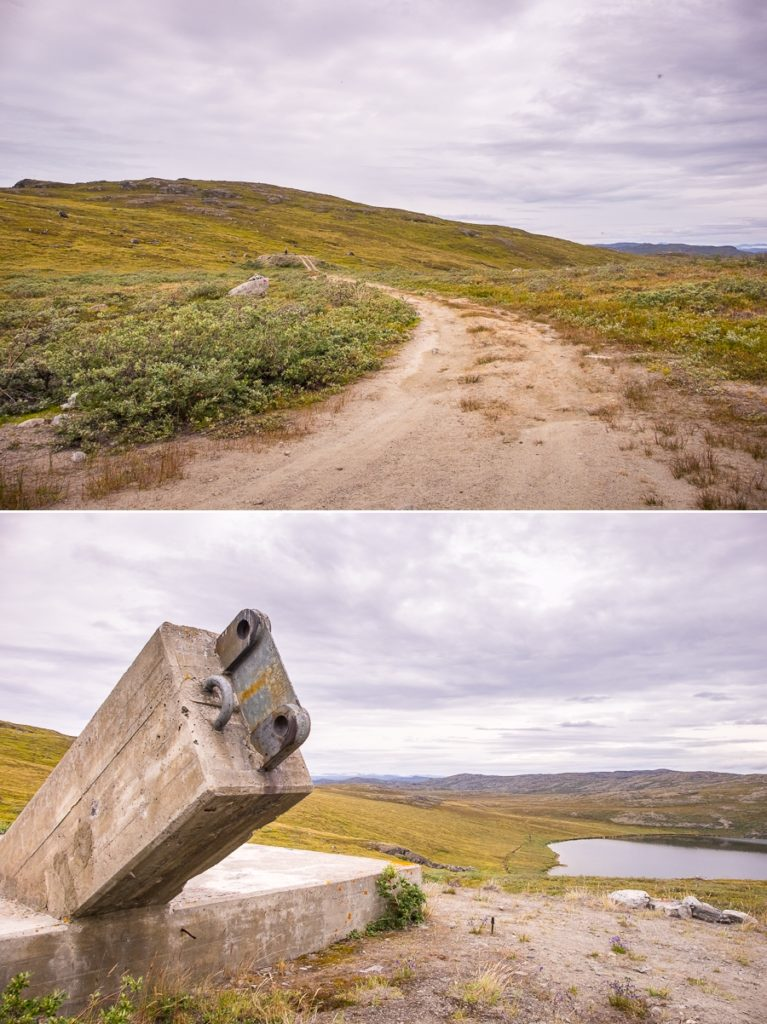 Road out to Kelly Ville and concrete plinth that marks the start of the Arctic Circle Trail near Kangerlussuaq, West Greenland
