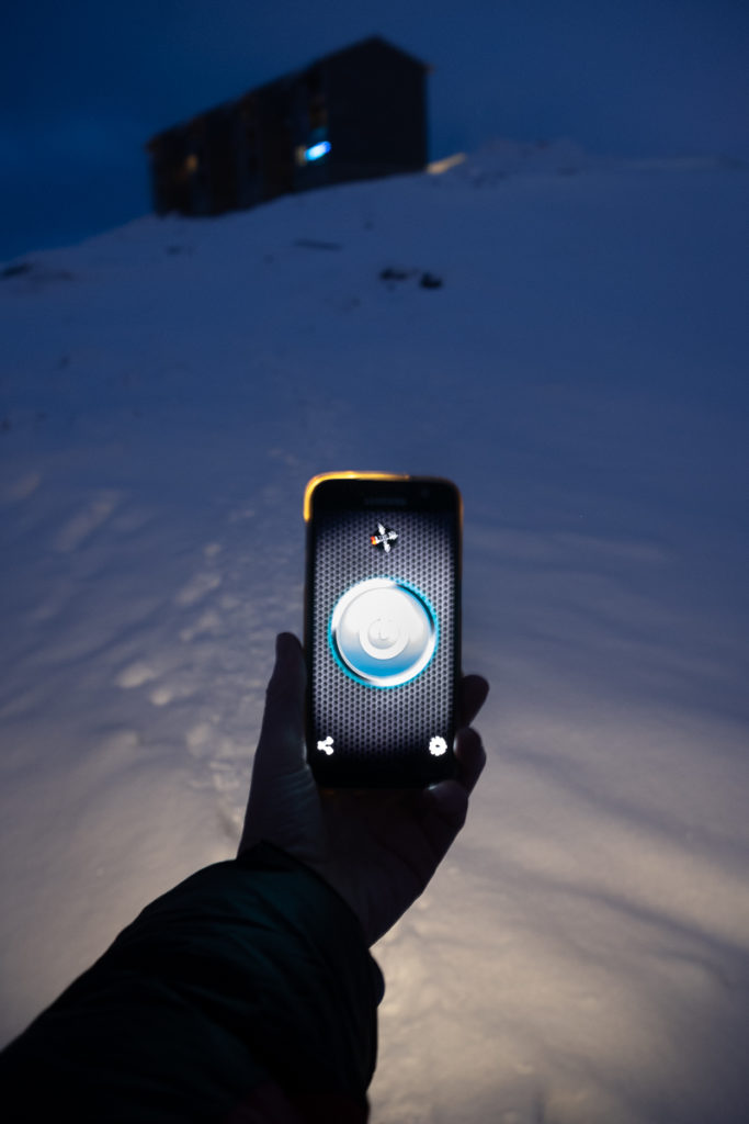 Image of phone with flashlight on and my apartment in the background - Nuuk - Greenland