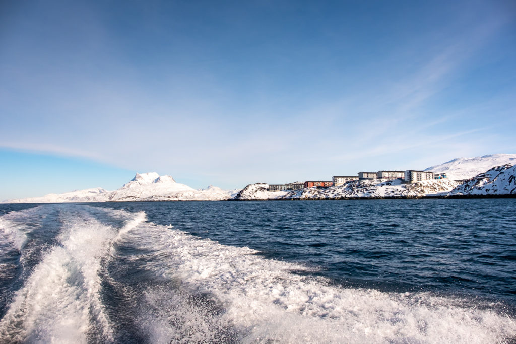 Nuuk, the wash of the boat and Sermitsiaq in the background, West Greenland