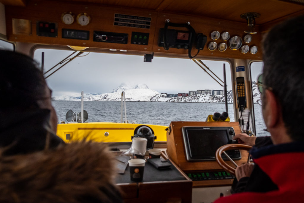 Looking out the windscreen of our boat towards Sermitsiaq mountain with its top lost in cloud - Nuuk - West Greenland