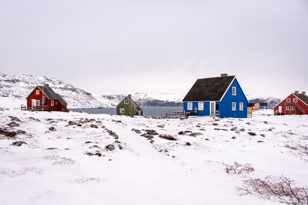 Colourful houses of Qoornoq and a path leading through the settlement - West Greenland