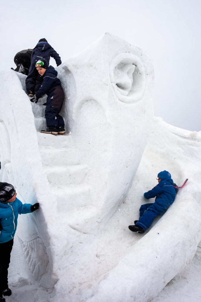 Kids playing on an interactive sculpture at the Nuuk Snow Festival - West Greenland