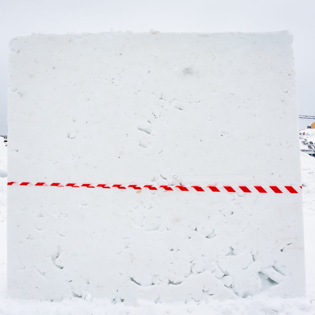 Untouched block of compacted snow - the starting point for all artists at the Nuuk Snow Festival - West Greenland