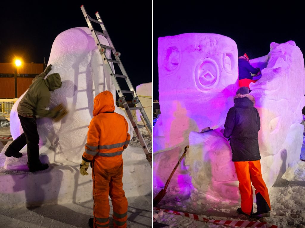Artists working during the night on their sculptures at the Nuuk Snow Festival - West Greenland