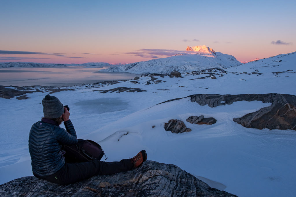 Me taking photographs of a glowing Sermitsiaq mountain from the viewpoint half way up Lille Malene - Nuuk - West Greenland
