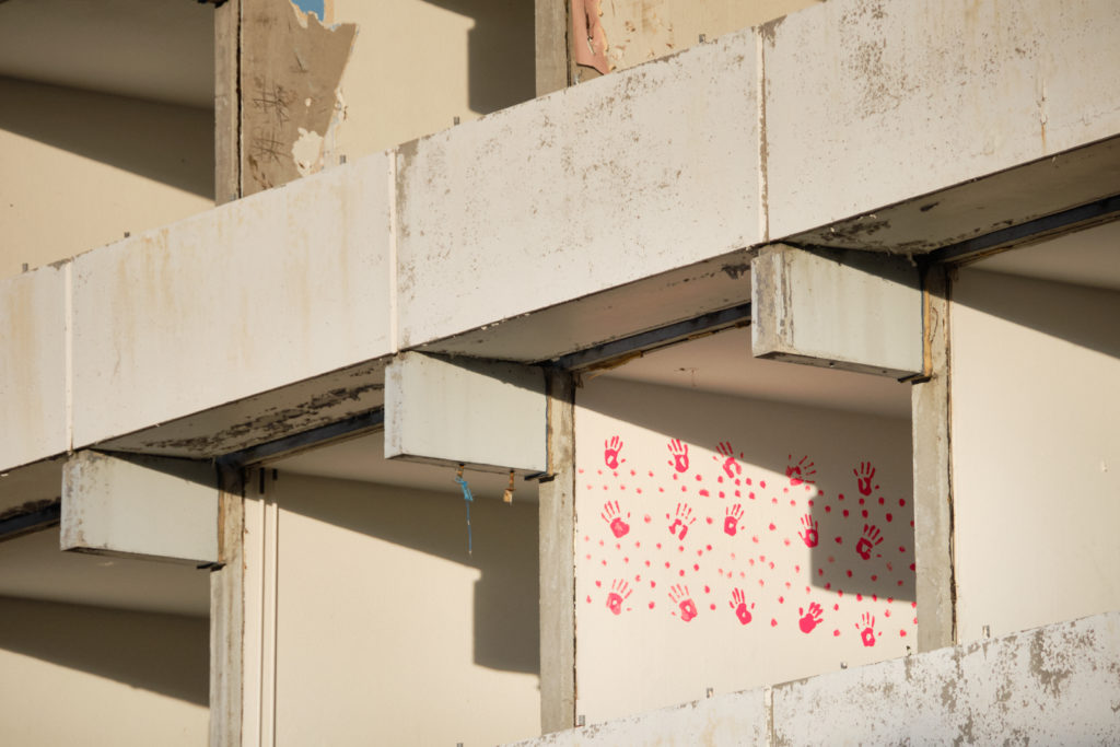 Pink handprints adorn one of the walls of an apartment in Block 1 - currently being demolished in Nuuk