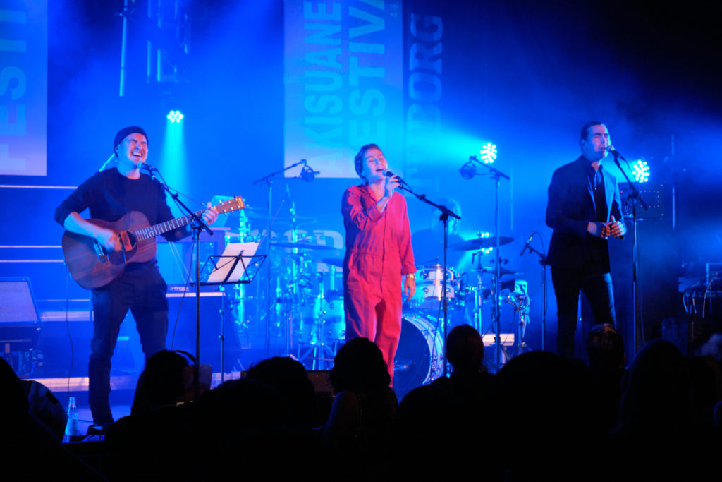 Adam, Kimmernaq and Nathan performing at the Akisuanerit Festival in Nuuk, 2019