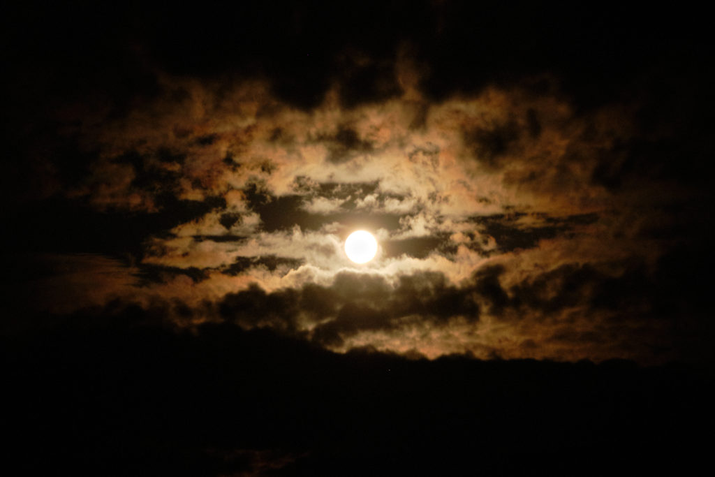 Moonrise surrounded by clouds